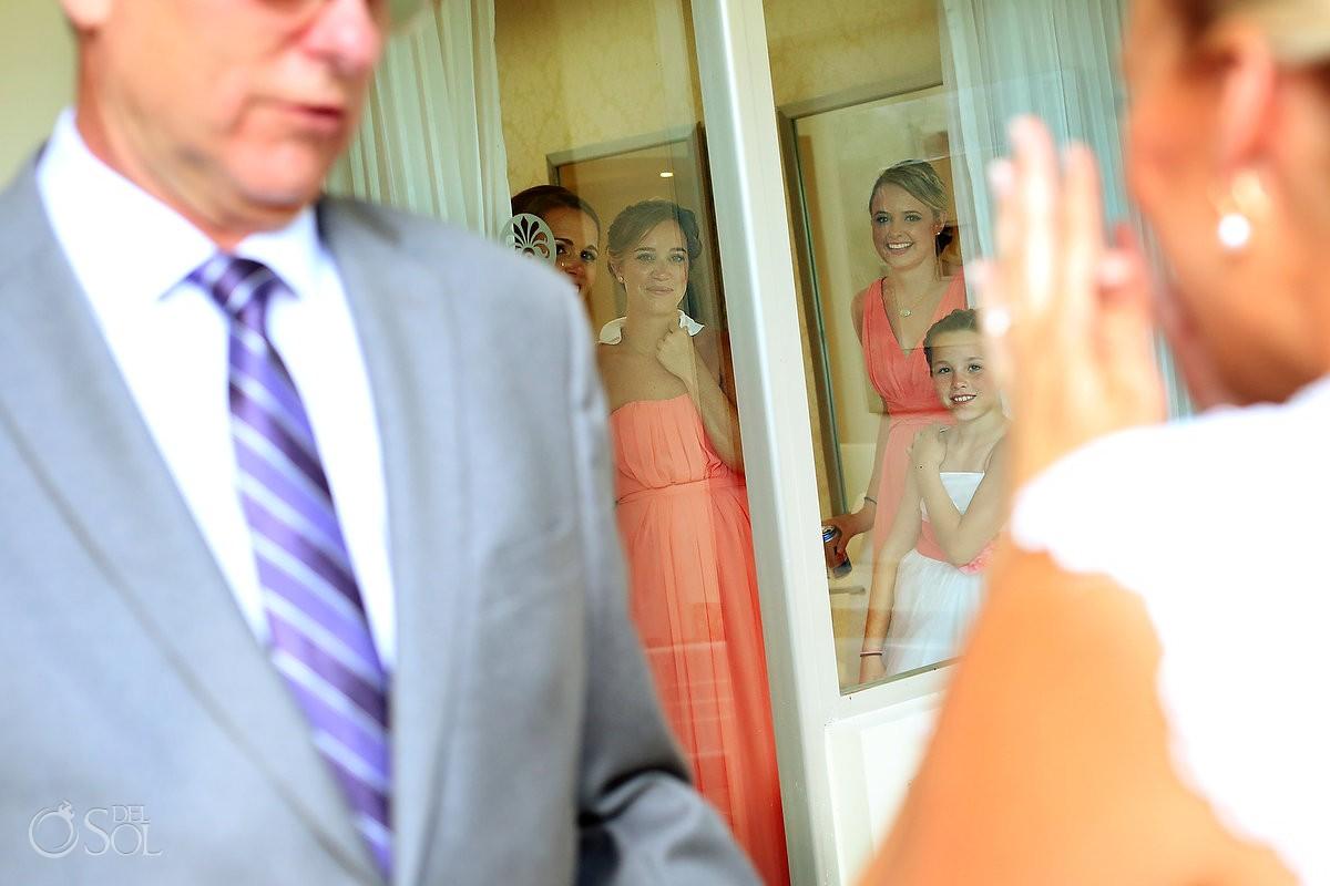 bridesmaids watching bride and father, getting ready bridal suite Destination Wedding Paradisus La Esmeralda