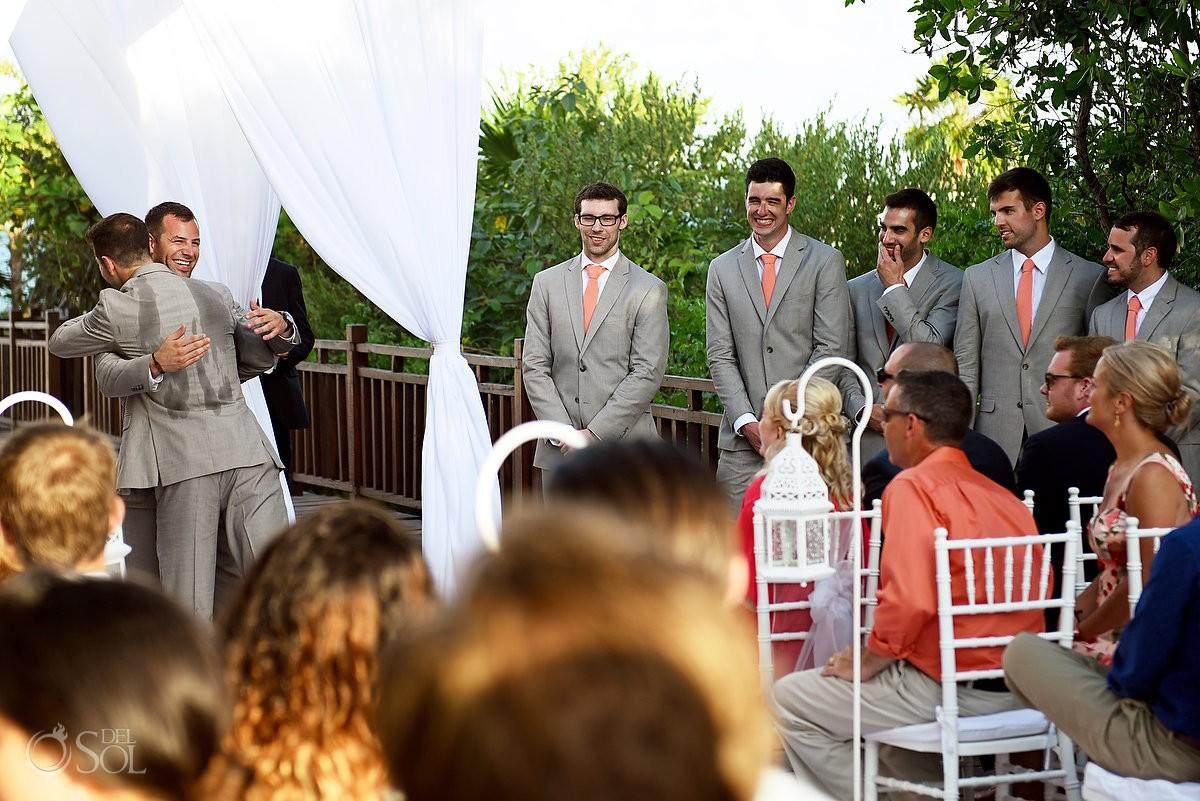 Hot day in paradise! Groomsman sweating through his suit jacket Destination Wedding Paradisus Gabi Bridge