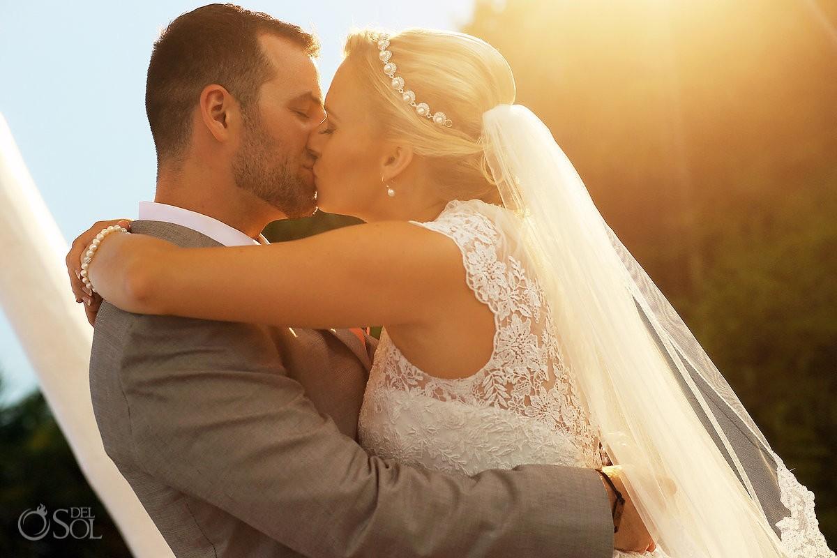 beautiful light sunset wedding portrait kiss Paradisus Playa del Carmen Mexico