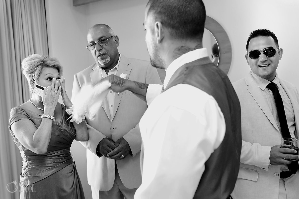 candid family love black and white wedding photo, groom getting ready Beach Palace, Cancun, Mexico