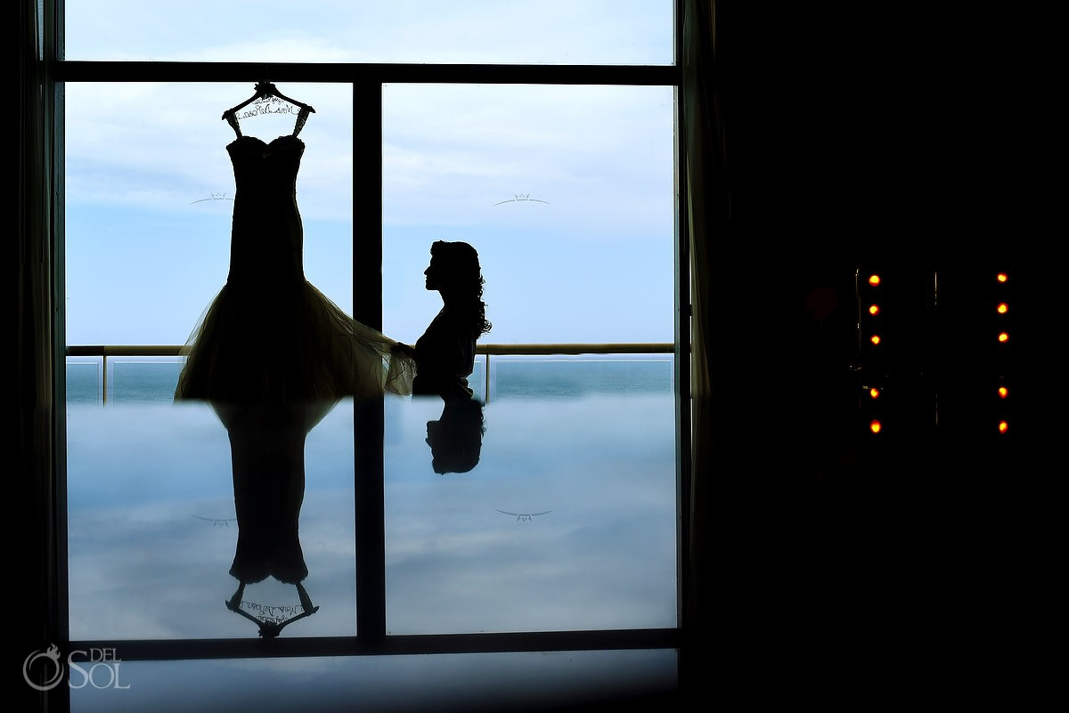 Artistic bride getting ready wedding dress silhouette, destination wedding Beach Palace, Cancun, Mexico