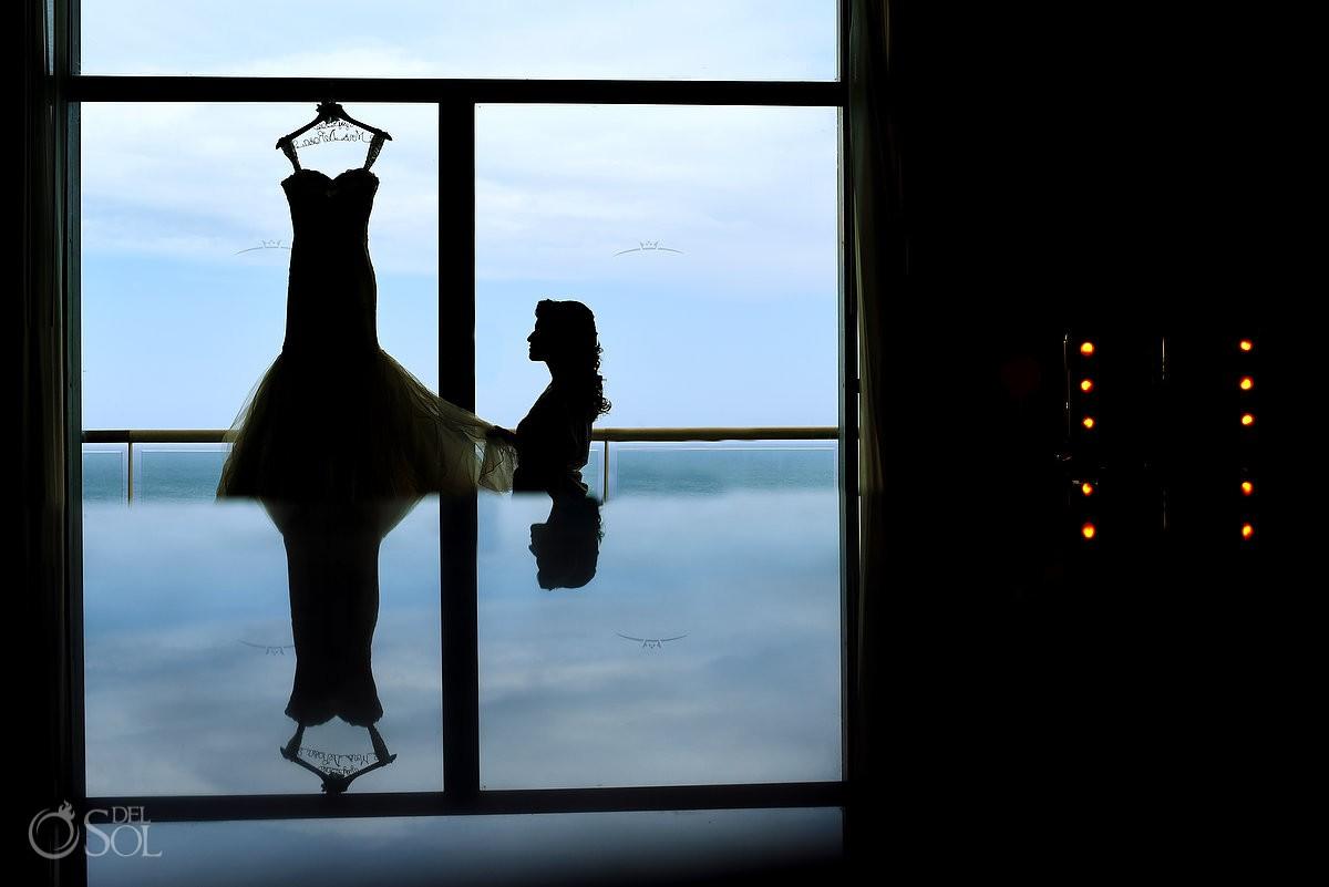 Artistic bride getting ready wedding dress silhouette, destination wedding Beach Palace, Cancun, Mexico