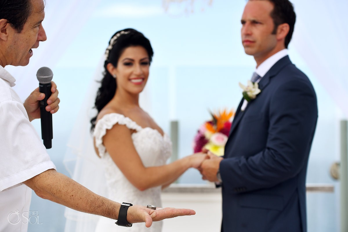 hand detail holding wedding band ceremony Beach Palace sky deck, Cancun, Mexico