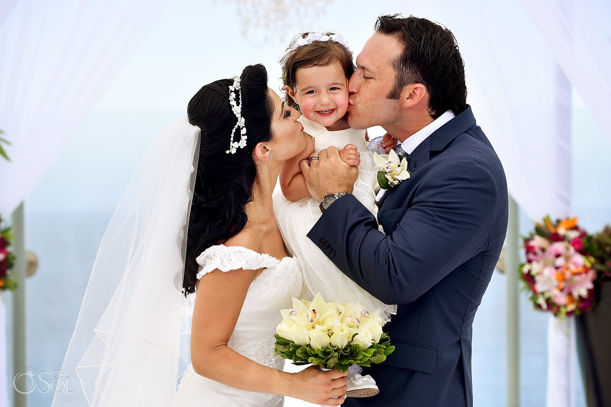 bride groom and daughter kiss, cute family love moment destination wedding ceremony Beach Palace sky deck, Cancun, Mexico