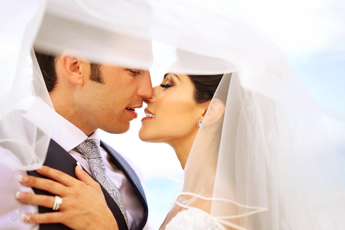 romantic wedding portrait with bridal veil Beach Palace Cancun, Mexico