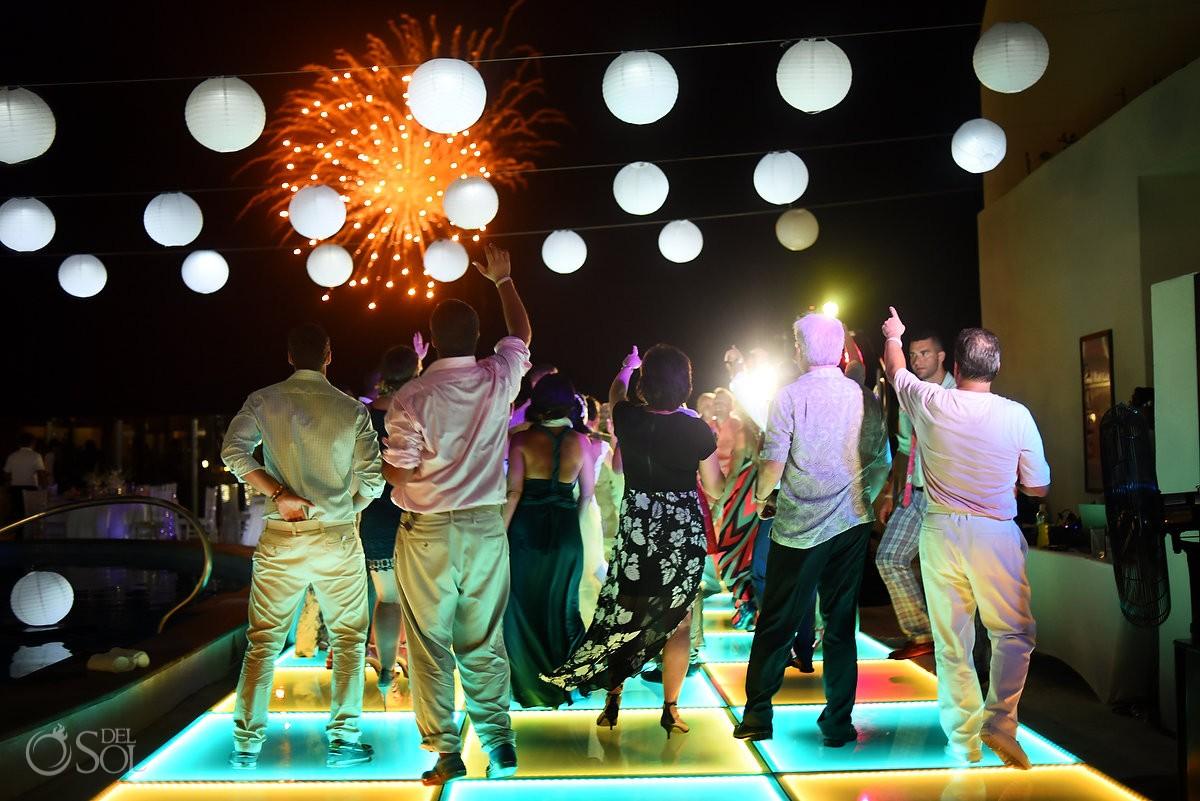 4th July fireworks over dance floor destination wedding reception Party Beach Palace Cancun Sky Terrace