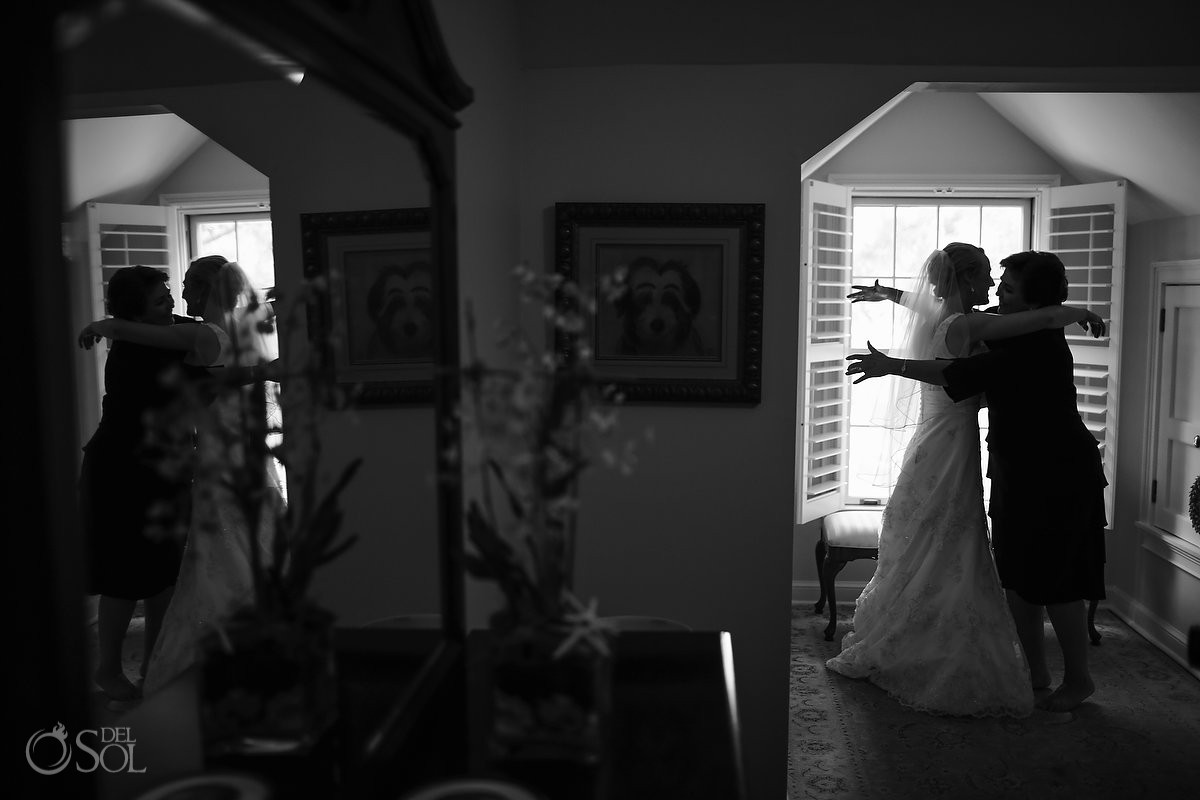 bride hugging her mother wearing a Wedding Dress by Alfred Angelo