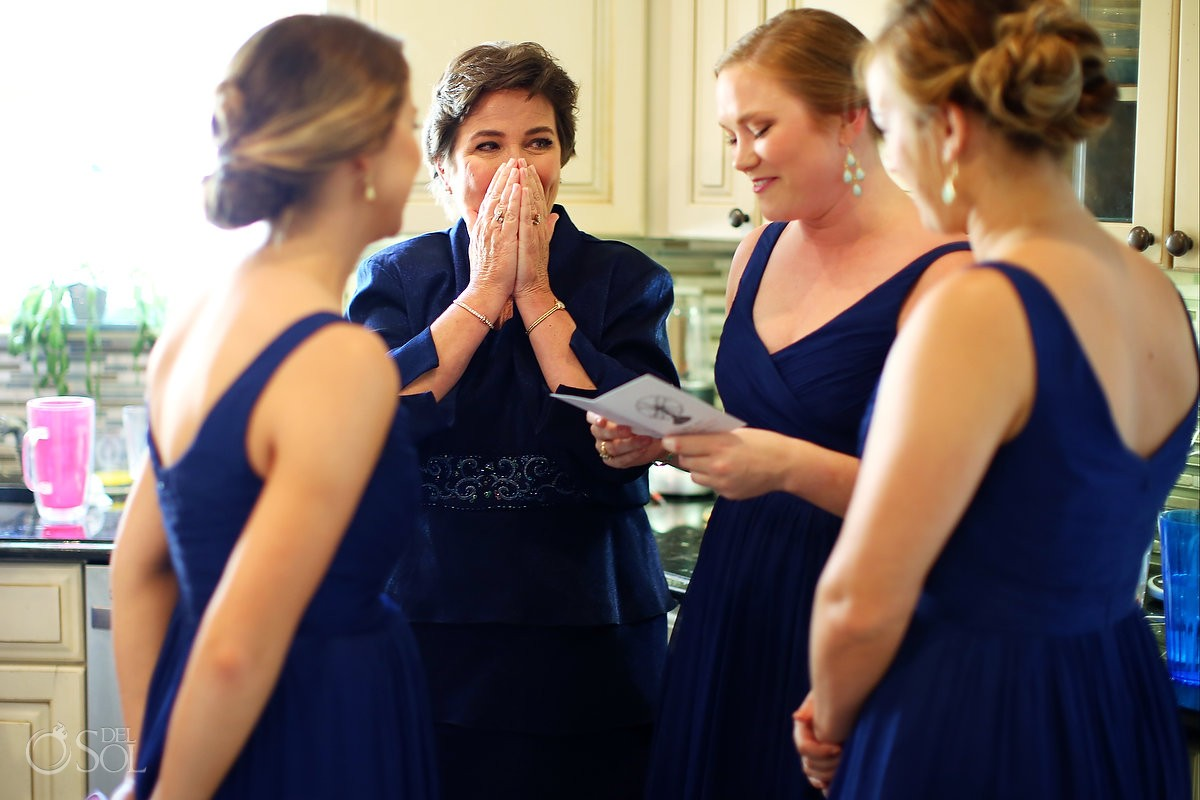 mother crying with bridesmaids