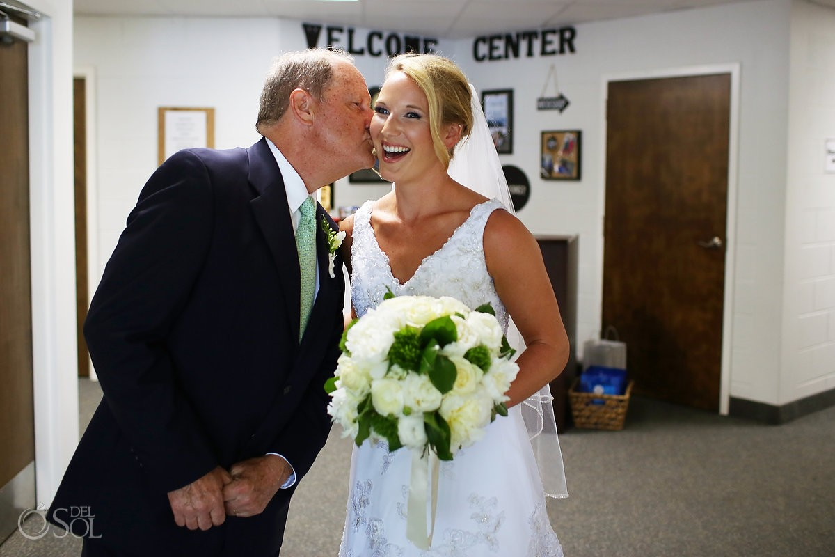St. Simons wedding father of the bride special moment of celebration and kisses
