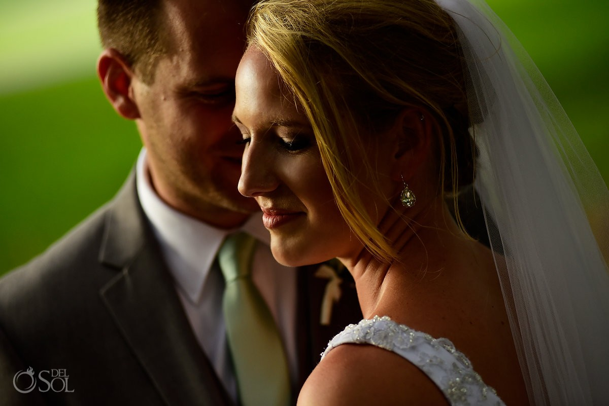 bride and groom embrace at avenue of the oaks st simons island St. Simons wedding
