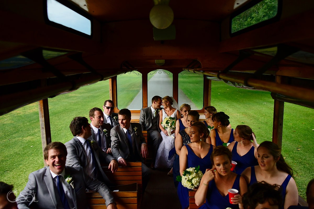 bride and groom on trolley at avenue of the oaks st simons island wedding