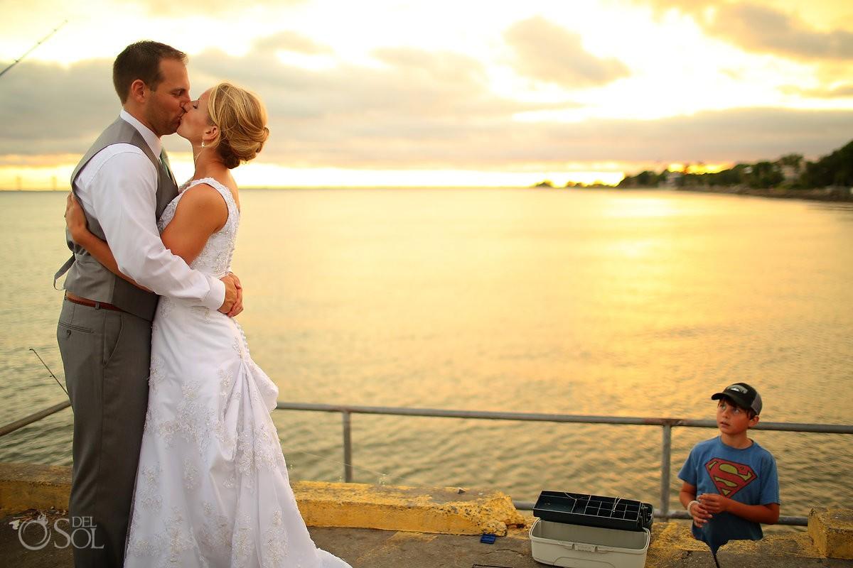 destination wedding photo of bride and groom on st simons island super man shirt