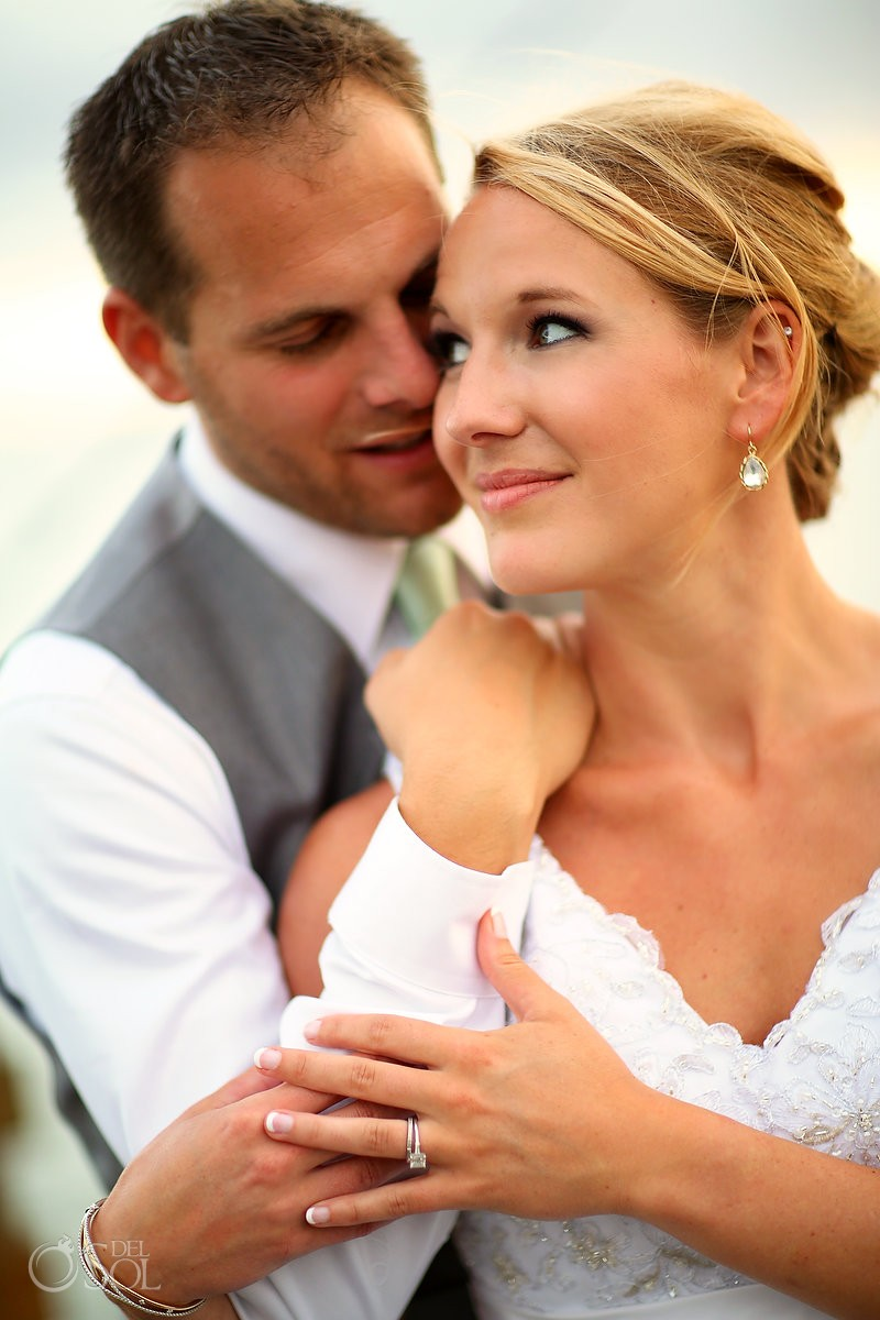 bride and groom embrace for wedding photography at st simons island