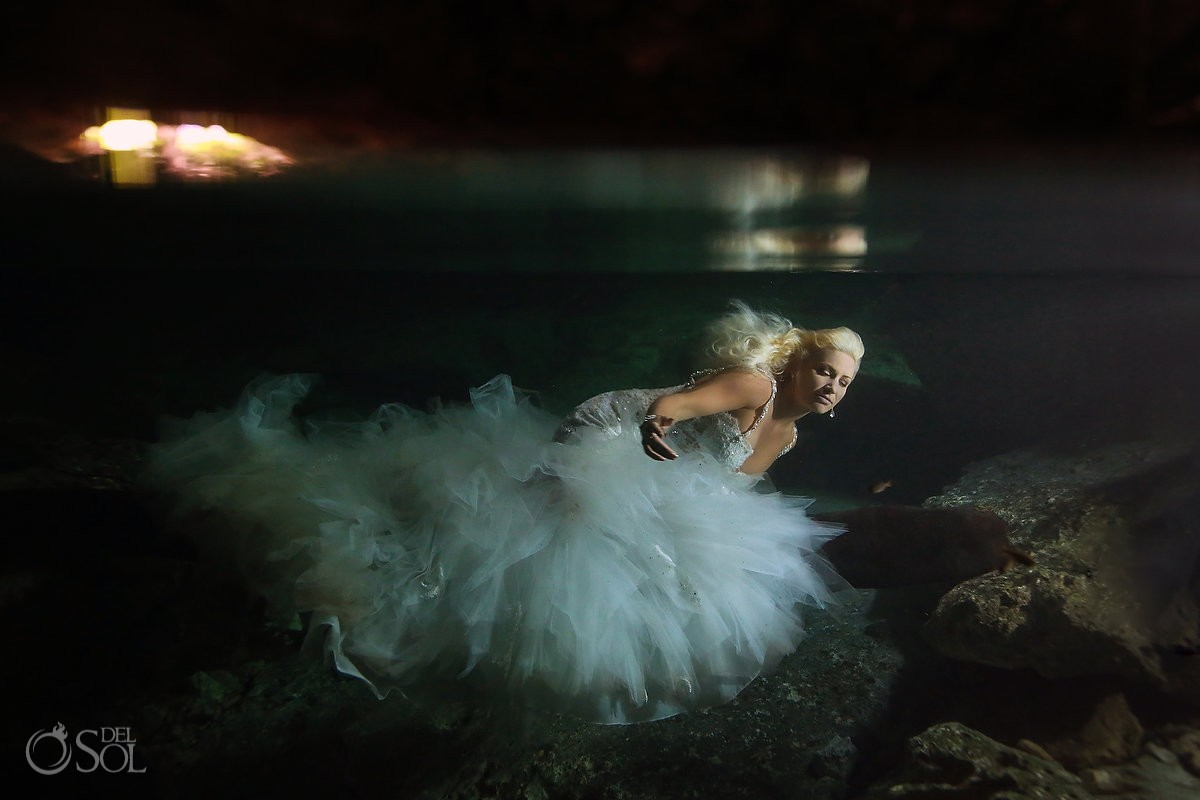 Beautiful bride reflection underwater trash the dress