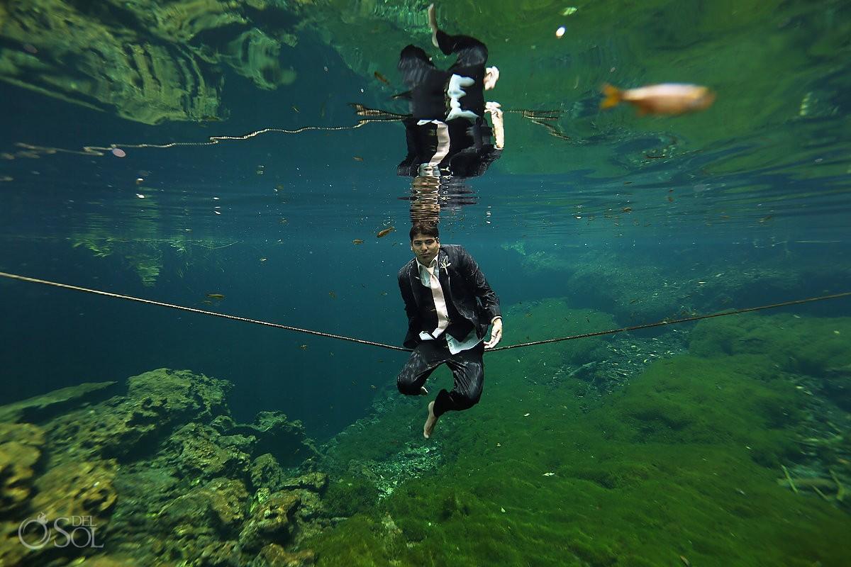 groom underwater wedding photo cenote trash the dress Riviera Maya Mexico