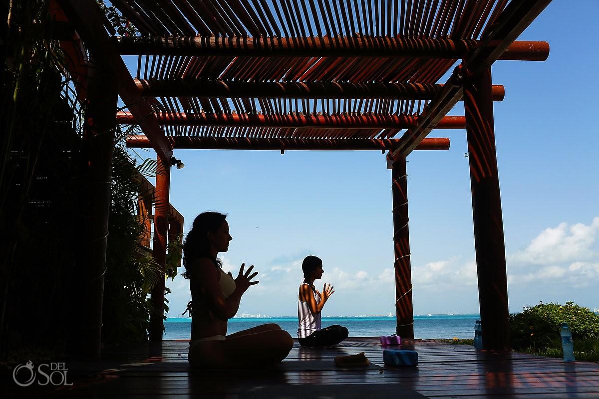 yoga pose caribbean ocean Zoetry Villa Rolandi, Isla Mujeres, Cancun, Mexico.