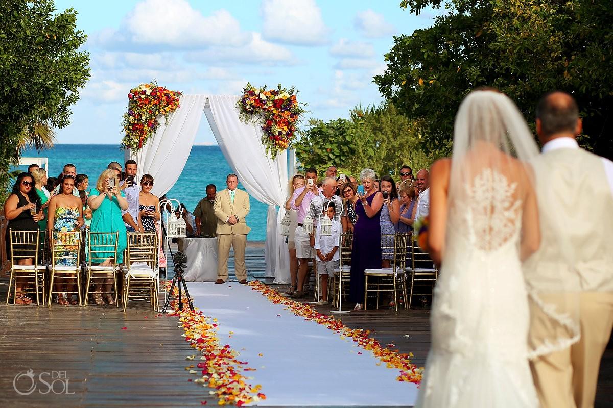 Bride entrance Paradisus Gabi bridge beautiful bright orange floral display by Planner 1 events, Playa del Carmen, Mexico