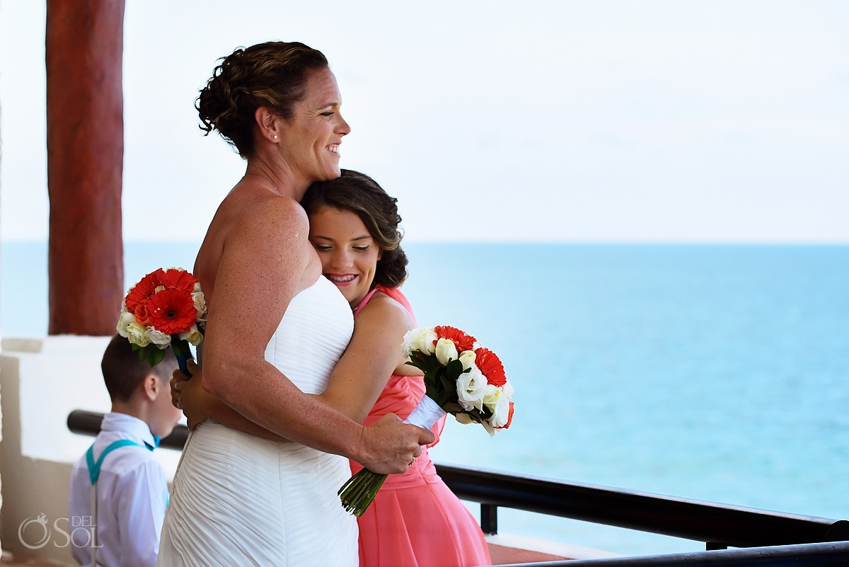bride and daughter hugging destination beach wedding in mexico