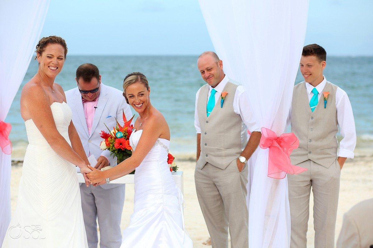 two brides laughing destination beach wedding in Puerto morelos mexico