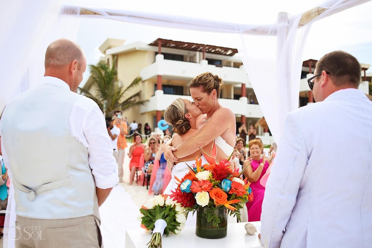 same sex brides first kiss beach destination wedding