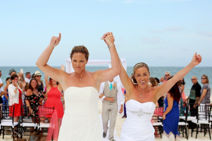 same sex brides exit beach destination wedding celebrating