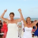 same sex brides exit beach destination wedding celebrating