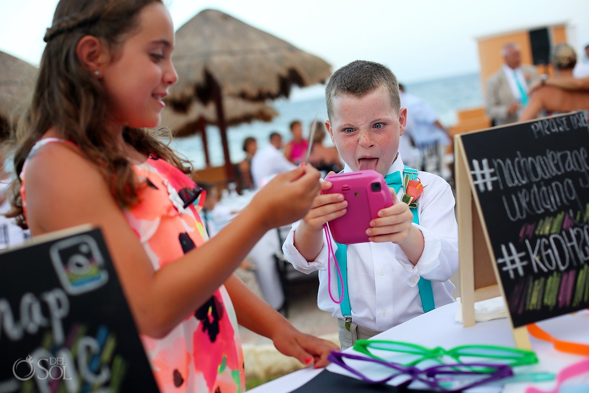 cute kids poses for fun selfie photography at beach wedding