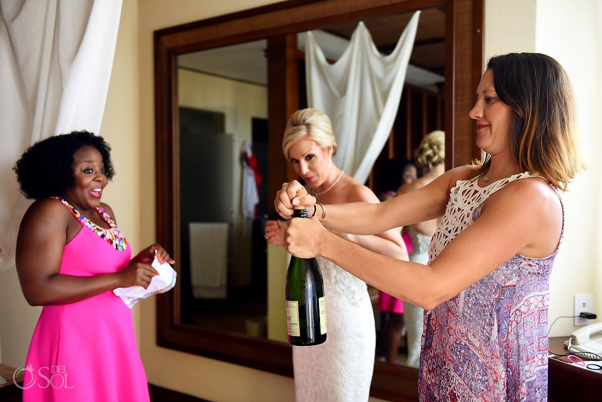 Fun toast, getting ready bride's room Destination wedding Dreams Riviera Cancun