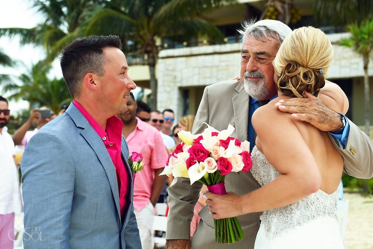 Bride and father hugging at wedding ceremony Cancun, Mexico