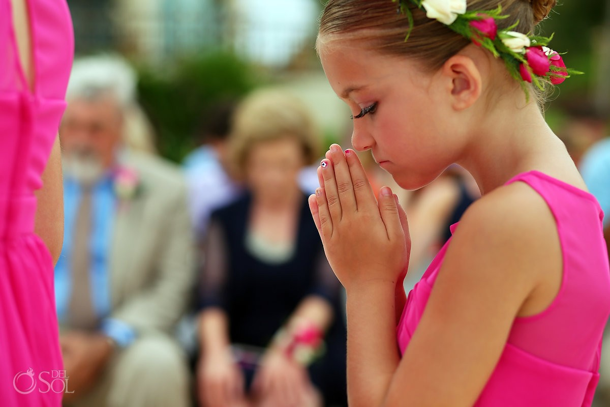 flower girl praying at wedding ceremony Cancun, Mexico