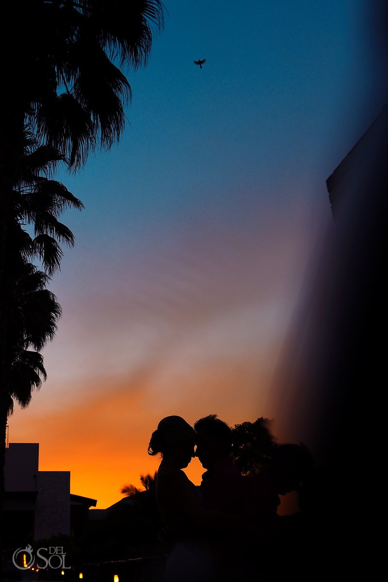 Amazing sunset bride and groom portrait Destination wedding Dreams Riviera Cancun