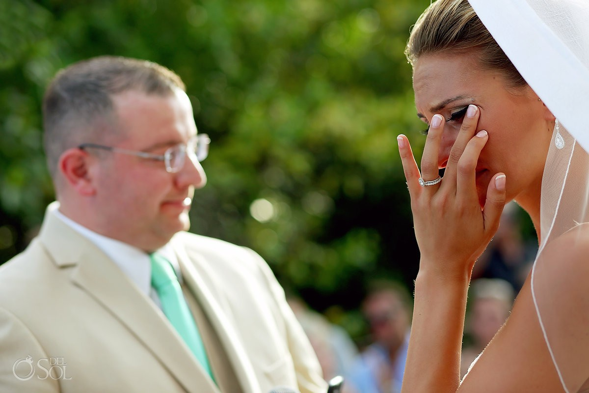briude wiping tear emotional ceremony moment destination wedding Gabi Bridge Paradisus La Esmeralda, Playa del Carmen, Mexico