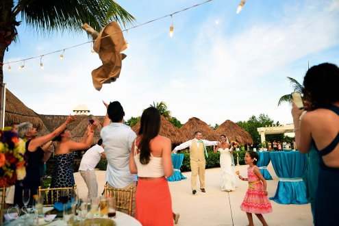 funny wedding reception entrance idea groom throwing suit The Solarium Paradisus La Esmeralda