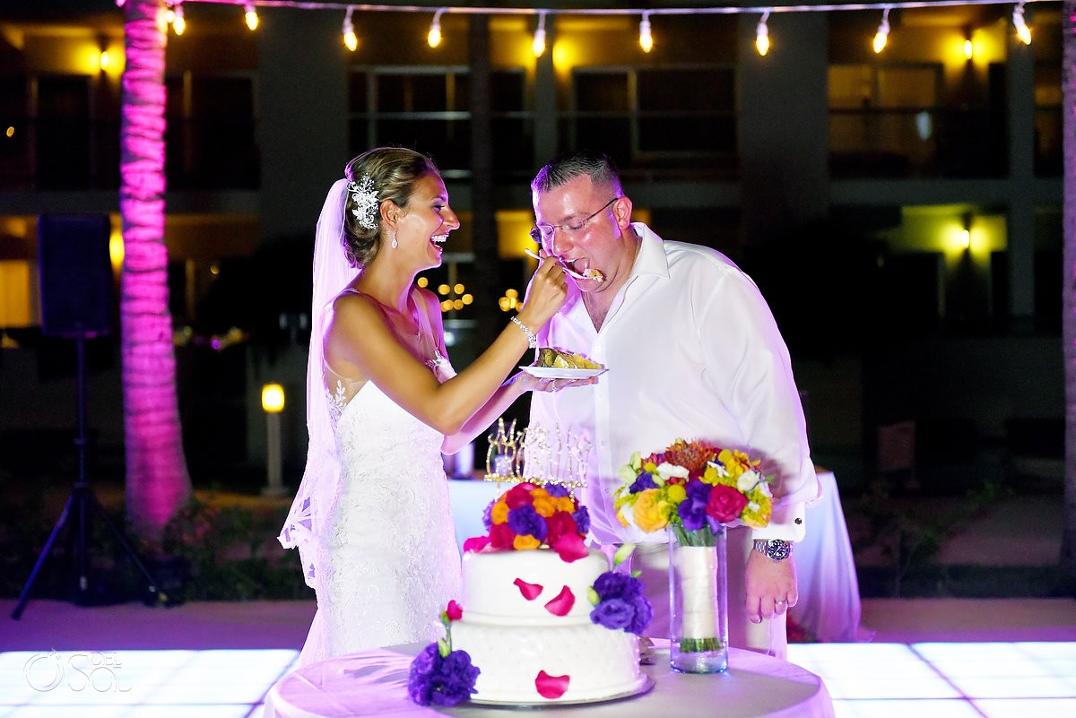 funny cake cutting photo destination wedding reception The Solarium Paradisus La Esmeralda