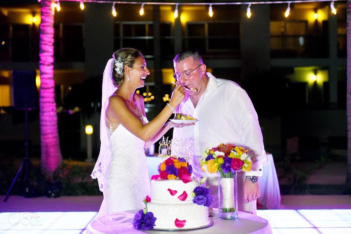 funny cake cutting photo destination wedding reception The Solarium Paradisus La Esmeralda
