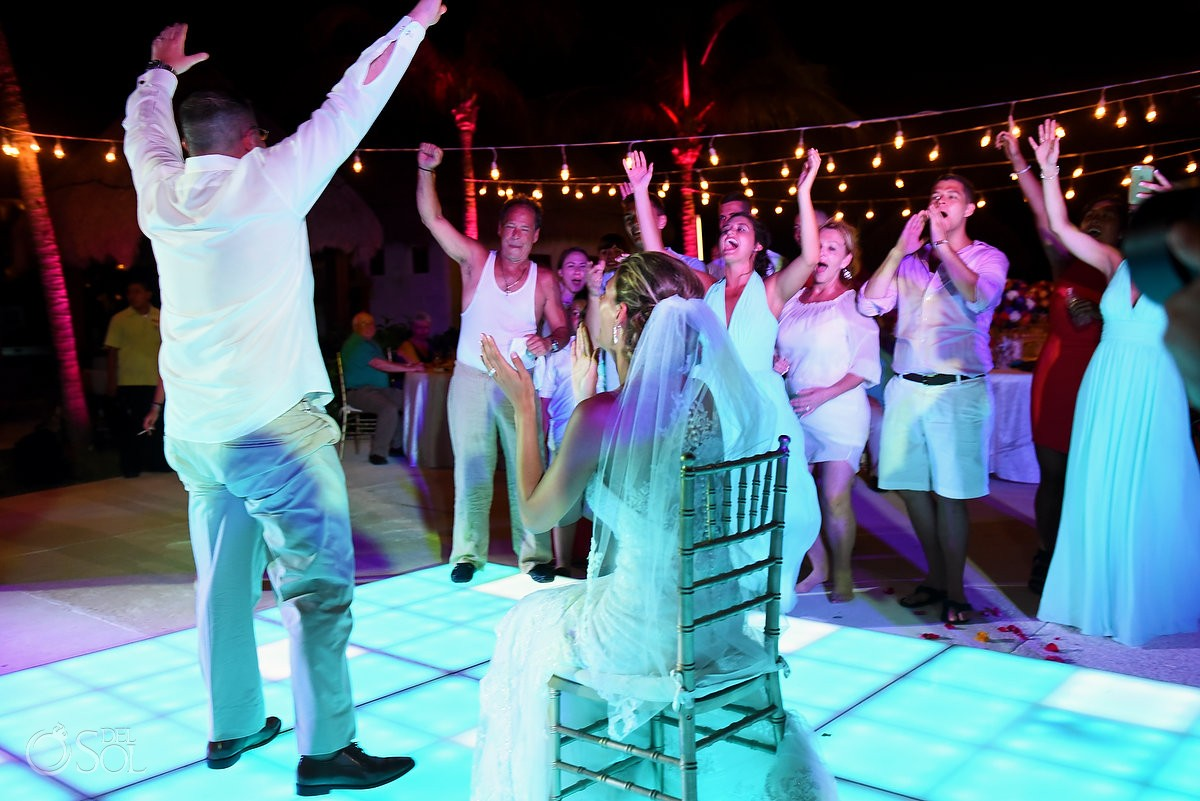 funny garter toss photo destination wedding reception The Solarium Paradisus La Esmeralda