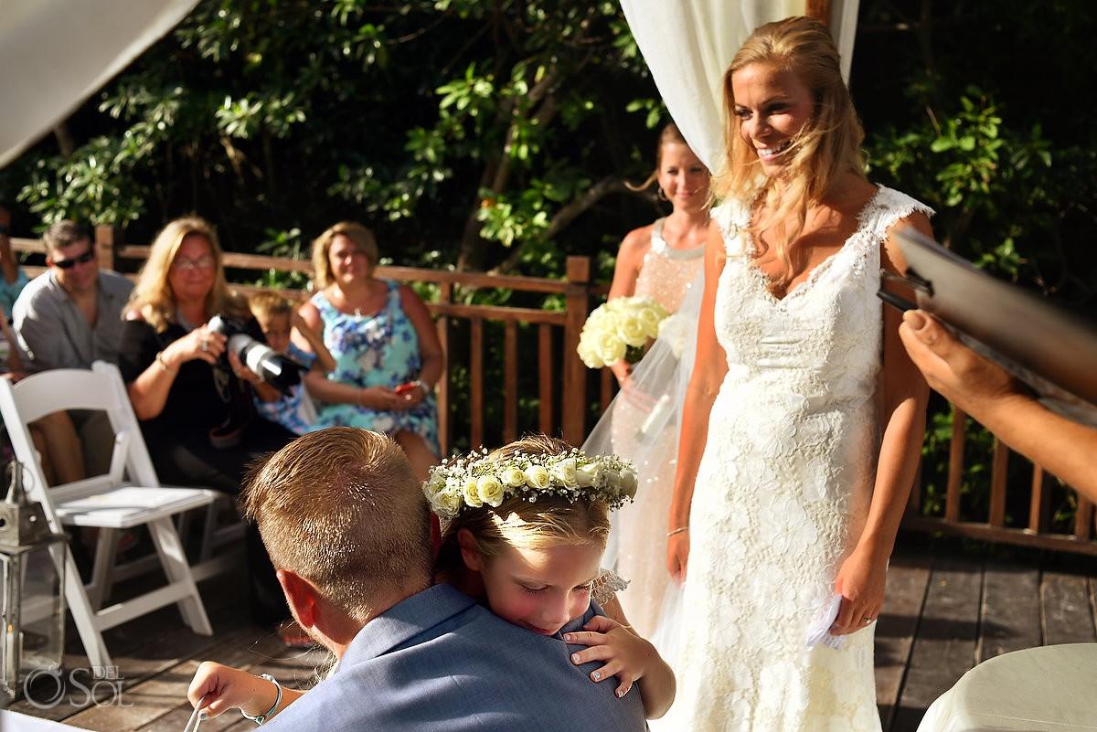Including children in your wedding ceremony, groom hugs brides daughter Paradisus La Esmeralda Gabi Bridge