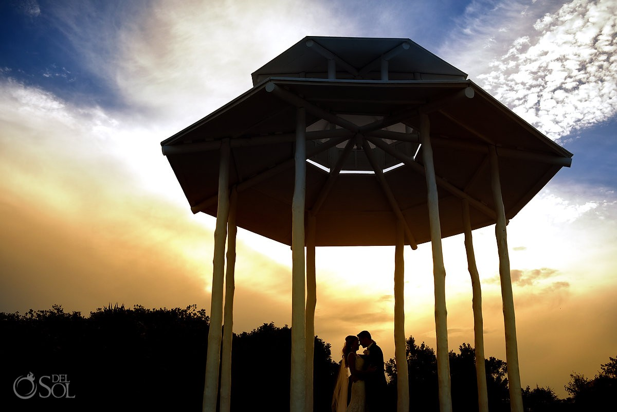 Amazing silhouette sunset wedding portrait, Paradisus beach gazebo Playa del Carmen
