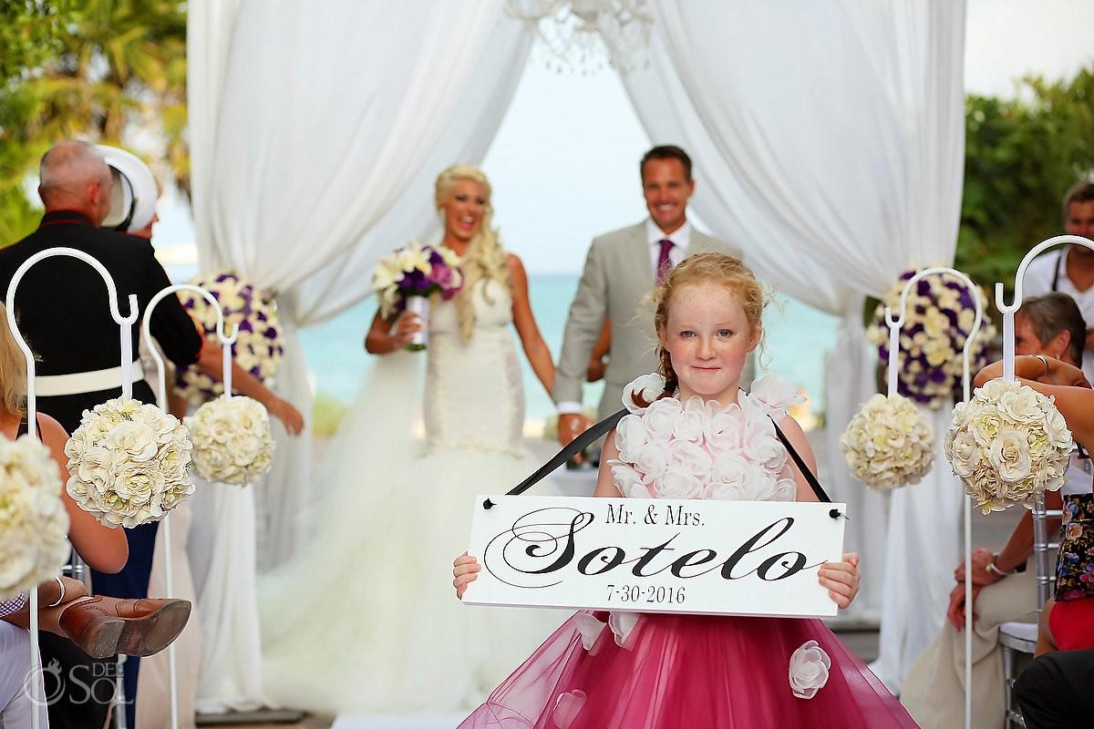 Wedding ceremony exit cute flower girl holding custom Mr & Mrs wedding sign Gabi Bridge Paradisus La Perla