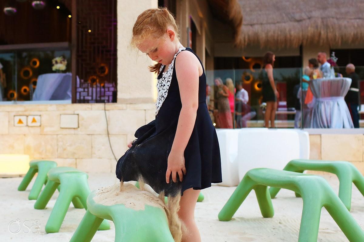 flower girl playing with sand Gabi Beach Club Destination Wedding reception Paradisus La Perla, Playa del Carmen, Mexico