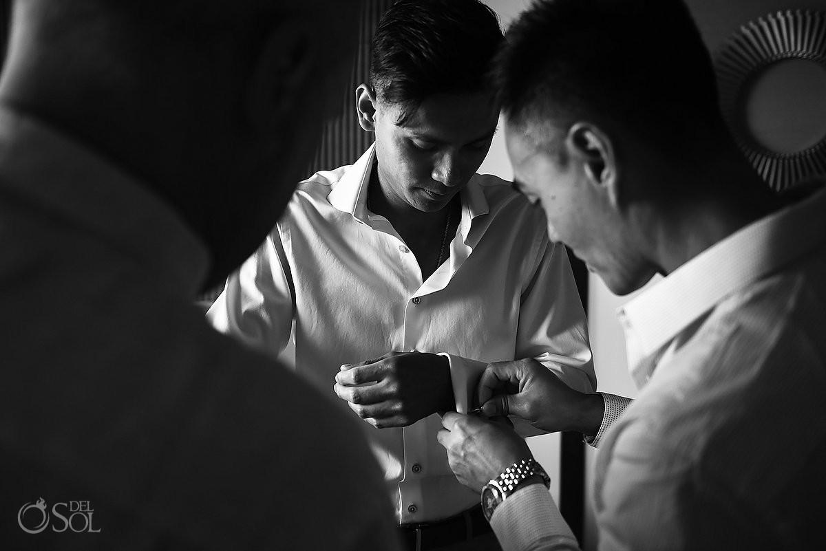 Black white monochrome groom getting ready portrait, destination wedding Royalton Riviera Cancun, Mexico