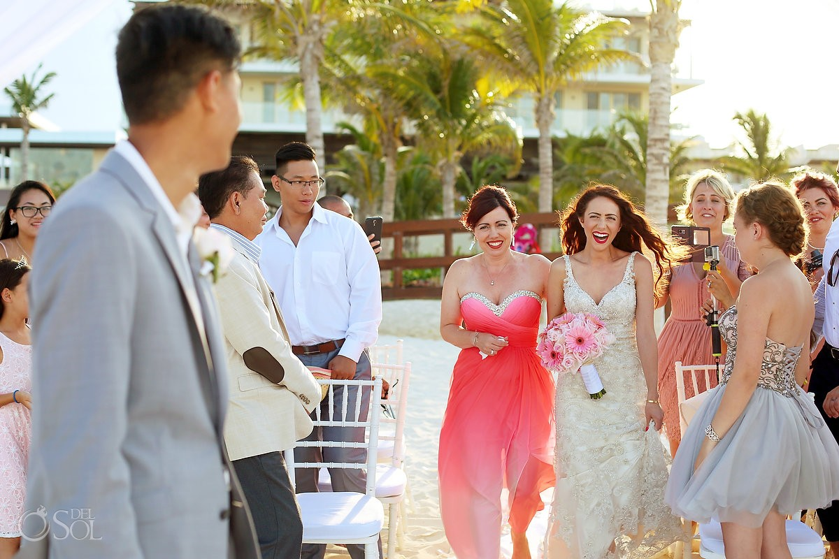 Bride's entrance destination beach wedding ceremony first look Royalton Riviera Cancun, Mexico