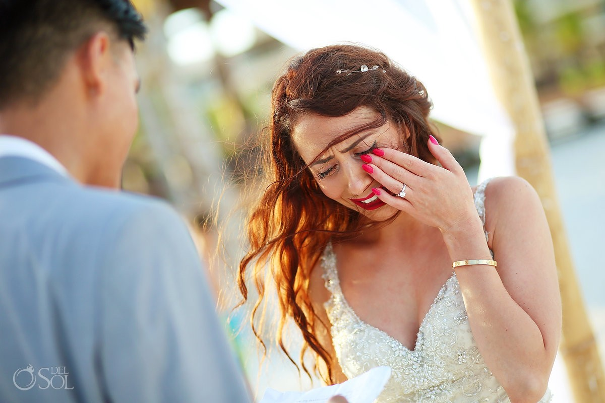 bride crying reading vows, tears of joy, emotional wedding ceremony moment, beach Royalton Riviera Cancun, Mexico