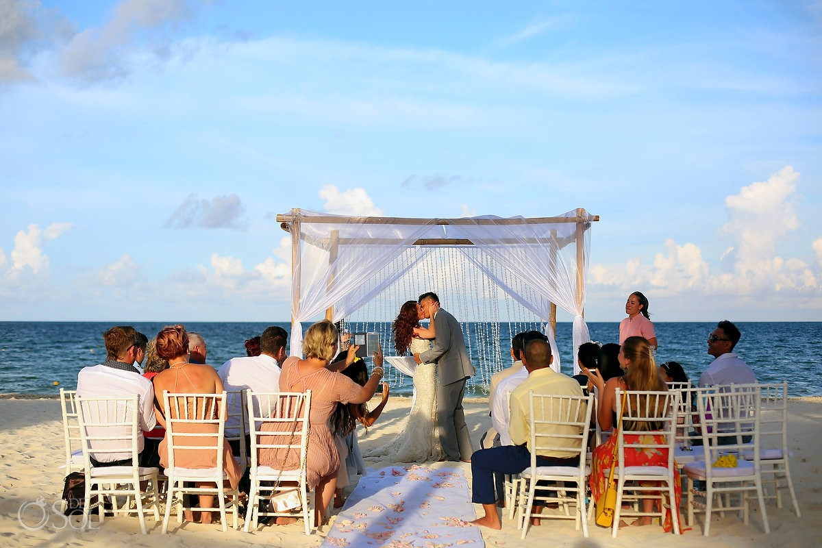 first kiss bride groom beach wedding ceremony, Royalton Riviera Cancun, Mexico