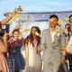 ceremony exit idea wedding guest throw bright yellow flowers confetti, just married, destination wedding Royalton Riviera Cancun, Mexico