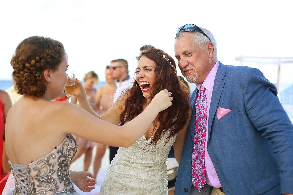 bride family celebration hug, destination wedding Royalton Riviera Cancun, Mexico