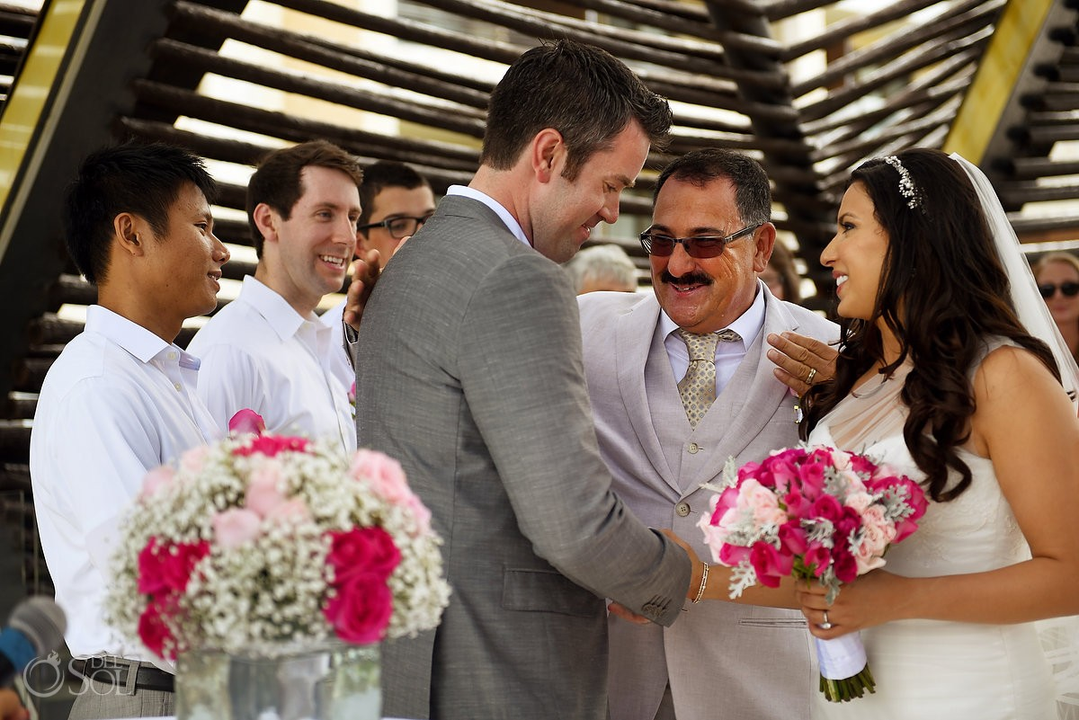 emotional wedding ceremony moment father gives daughter away, presentation of the bride Royalton Riviera Cancun chapel