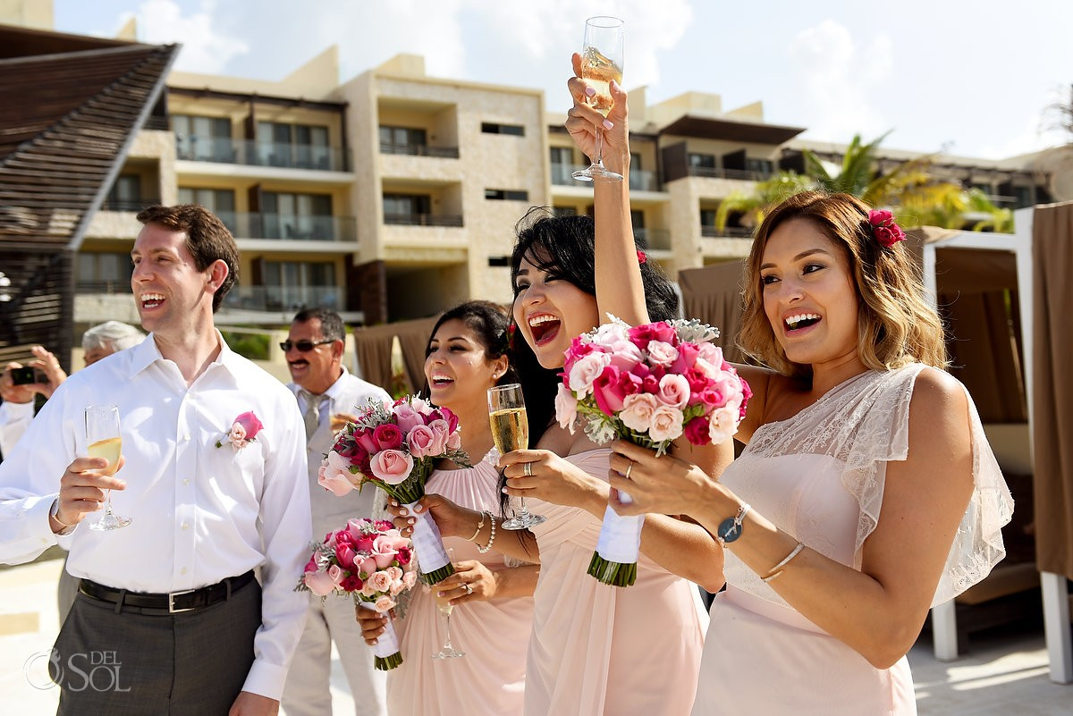 bridemaids fun moment destination wedding cocktail hour Royalton Riviera Cancun beach bar, Mexico