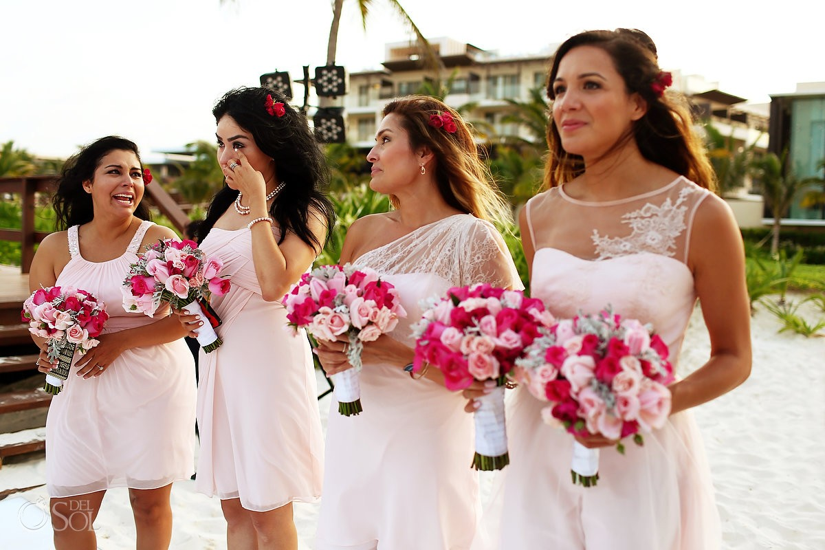 emotional bridemaids watching first dance, destination wedding reception Royalton Riviera Cancun beach bar, Mexico