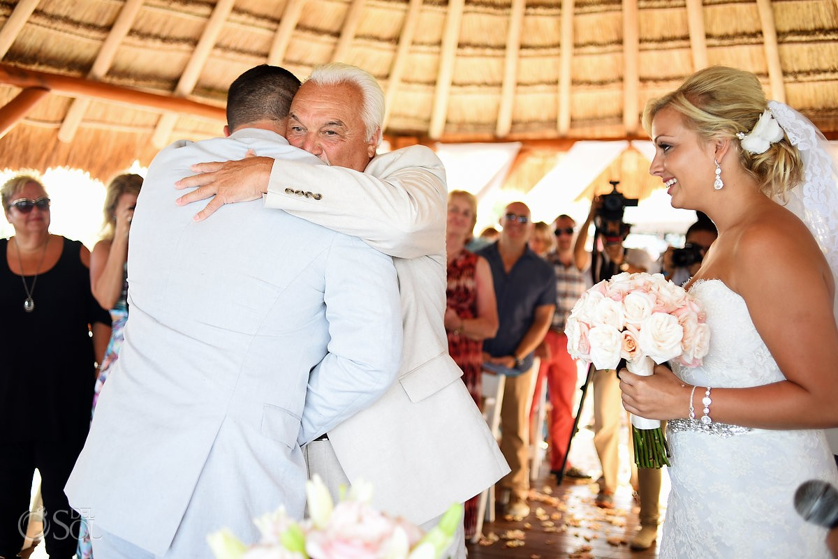 father bride hugs groom emotional family moment Wedding Ceremony Secrets Silversands gazebo Riviera Cancun, Mexico